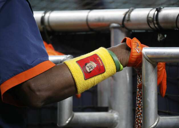 Houston Astros manager Dusty Baker Jr. wears an arm band with his likeness on it during batting practice before the start of an MLB baseball game at Minute Maid Park, Friday, June 18, 2021. Photo: Karen Warren/Staff Photographer / @2021 Houston Chronicle