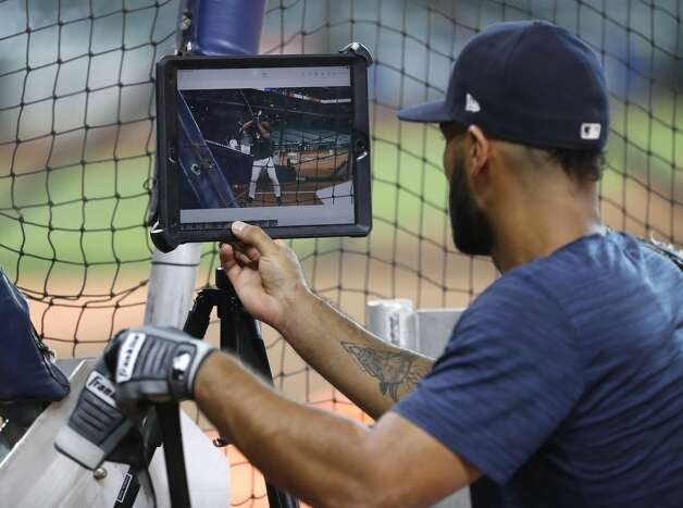 Houston Astros Abraham Toro checks video on his swing during batting practice before the start of an MLB baseball game at Minute Maid Park, Friday, June 18, 2021. Photo: Karen Warren/Staff Photographer / @2021 Houston Chronicle
