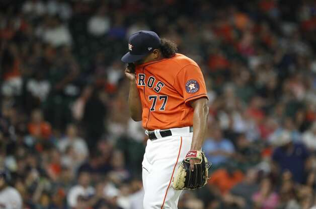 Houston Astros starting pitcher Luis Garcia (77) wipes his face after Chicago White Sox Andrew Vaughn flied out to end the top of the third inning of an MLB baseball game at Minute Maid Park, Friday, June 18, 2021. Photo: Karen Warren/Staff Photographer / @2021 Houston Chronicle