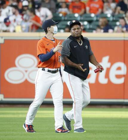 Houston Astros pitcher Framber Valdez (59) chats with Bill Murphy, assistant pitching coach before the start of the first inning of an MLB baseball game at Minute Maid Park, Friday, June 18, 2021. Photo: Karen Warren/Staff Photographer / @2021 Houston Chronicle