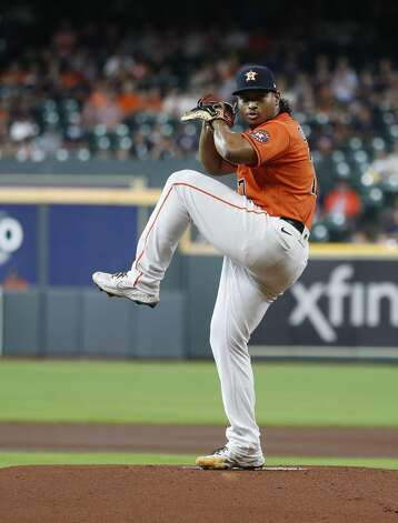 Houston Astros starting pitcher Luis Garcia (77) pitches during the first inning of an MLB baseball game at Minute Maid Park, Friday, June 18, 2021. Photo: Karen Warren/Staff Photographer / @2021 Houston Chronicle