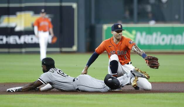 Chicago White Sox Brian Goodwin (18) slides into second base safely against Houston Astros shortstop Carlos Correa (1) during the first inning of an MLB baseball game at Minute Maid Park, Friday, June 18, 2021. Photo: Karen Warren/Staff Photographer / @2021 Houston Chronicle