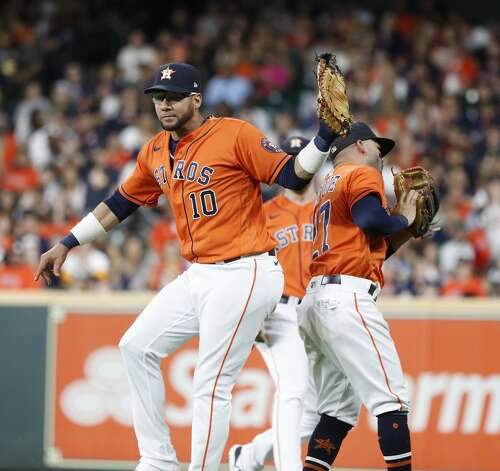 Houston Astros first baseman Yuli Gurriel (10) and second baseman Jose Altuve (27) nearly collide chasing Chicago White Sox second baseman Danny Mendick's fly out during the seventh inning of an MLB baseball game at Minute Maid Park, Friday, June 18, 2021. Photo: Karen Warren/Staff Photographer / @2021 Houston Chronicle