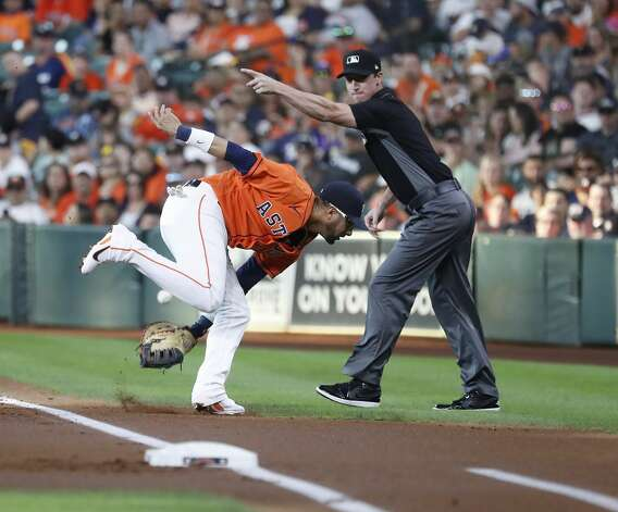 Houston Astros first baseman Yuli Gurriel (10) reaches for Chicago White Sox Brian Goodwin's double during the first inning of an MLB baseball game at Minute Maid Park, Friday, June 18, 2021. Photo: Karen Warren/Staff Photographer / @2021 Houston Chronicle