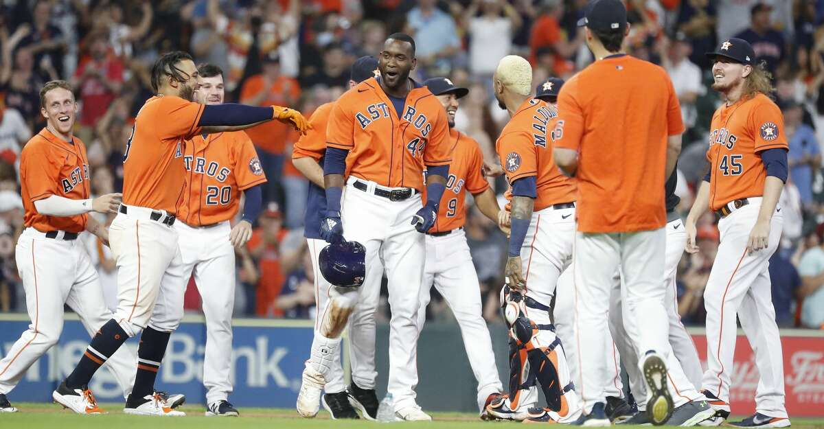 Houston Astros Yordan Alvarez (44) is surrounded by teammates after hitting an RBI double allowing Yuli Gurriel to score the game winning run during the ninth inning of an MLB baseball game at Minute Maid Park, Friday, June 18, 2021. Astros beat the Chicago White Sox 2-1.