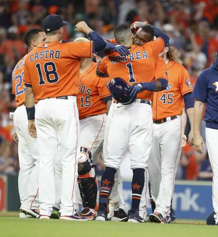 Houston Astros Yordan Alvarez (44) gets a hug from Carlos Correa (1) as he was surrounded by teammates after hitting an RBI double allowing Yuli Gurriel to score the game winning run during the ninth inning of an MLB baseball game at Minute Maid Park, Friday, June 18, 2021. Astros beat the Chicago White Sox 2-1. Photo: Karen Warren/Staff Photographer / @2021 Houston Chronicle