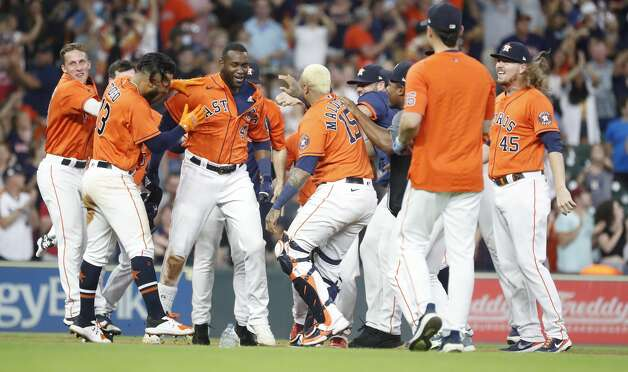 Houston Astros Yordan Alvarez (44) is surrounded by teammates after hitting an RBI double allowing Yuli Gurriel to score the game winning run during the ninth inning of an MLB baseball game at Minute Maid Park, Friday, June 18, 2021. Astros beat the Chicago White Sox 2-1. Photo: Karen Warren/Staff Photographer / @2021 Houston Chronicle