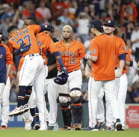 Houston Astros Yordan Alvarez (44) gets a hug from Jose Altuve (27) as he was surrounded by teammates after hitting an RBI double allowing Yuli Gurriel to score the game winning run during the ninth inning of an MLB baseball game at Minute Maid Park, Friday, June 18, 2021. Astros beat the Chicago White Sox 2-1. Photo: Karen Warren/Staff Photographer / @2021 Houston Chronicle