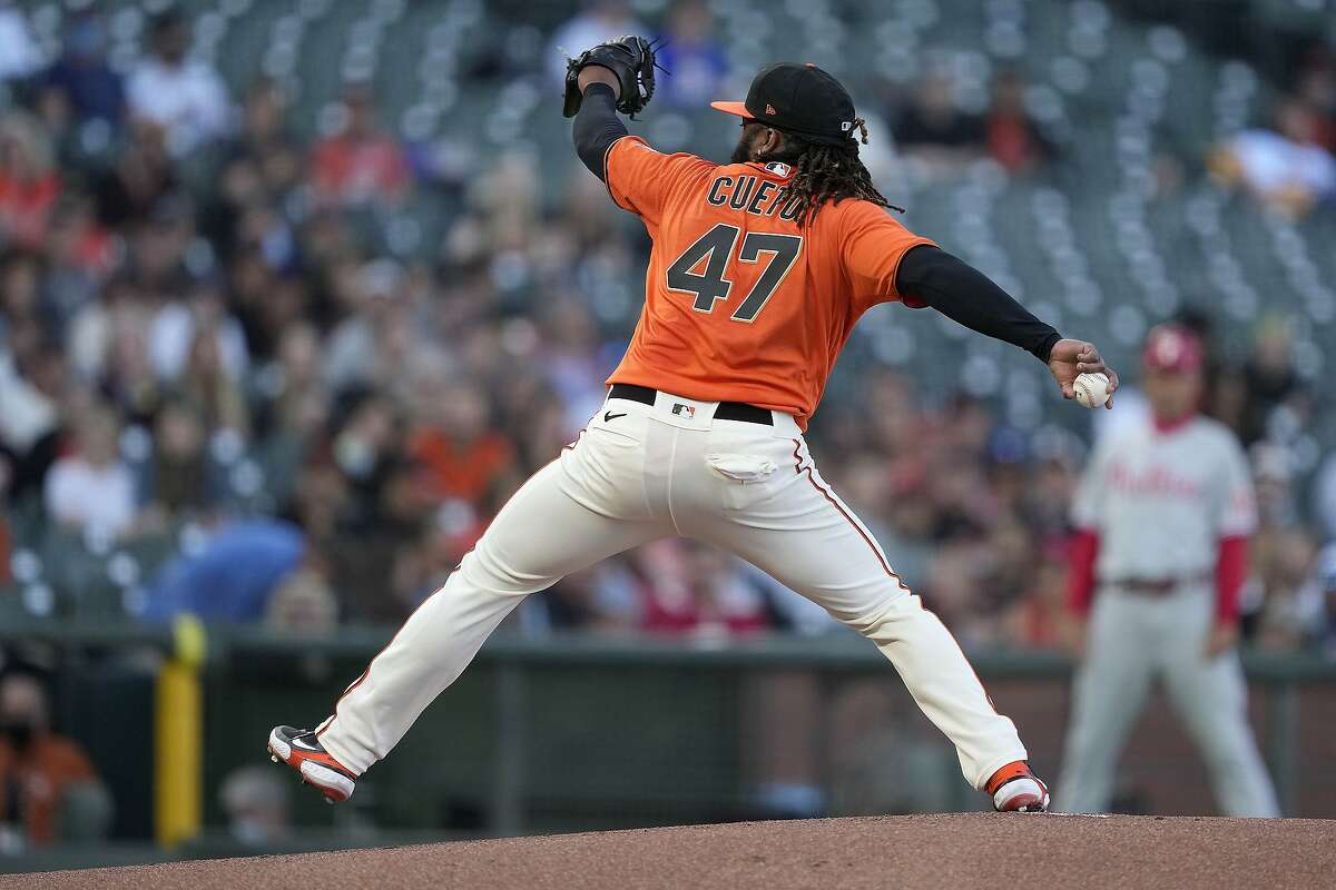San Francisco Giants starting pitcher Johnny Cueto throws to a Philadelphia Phillies batter during the first inning of a baseball game Friday, June 18, 2021, in San Francisco. (AP Photo/Tony Avelar)