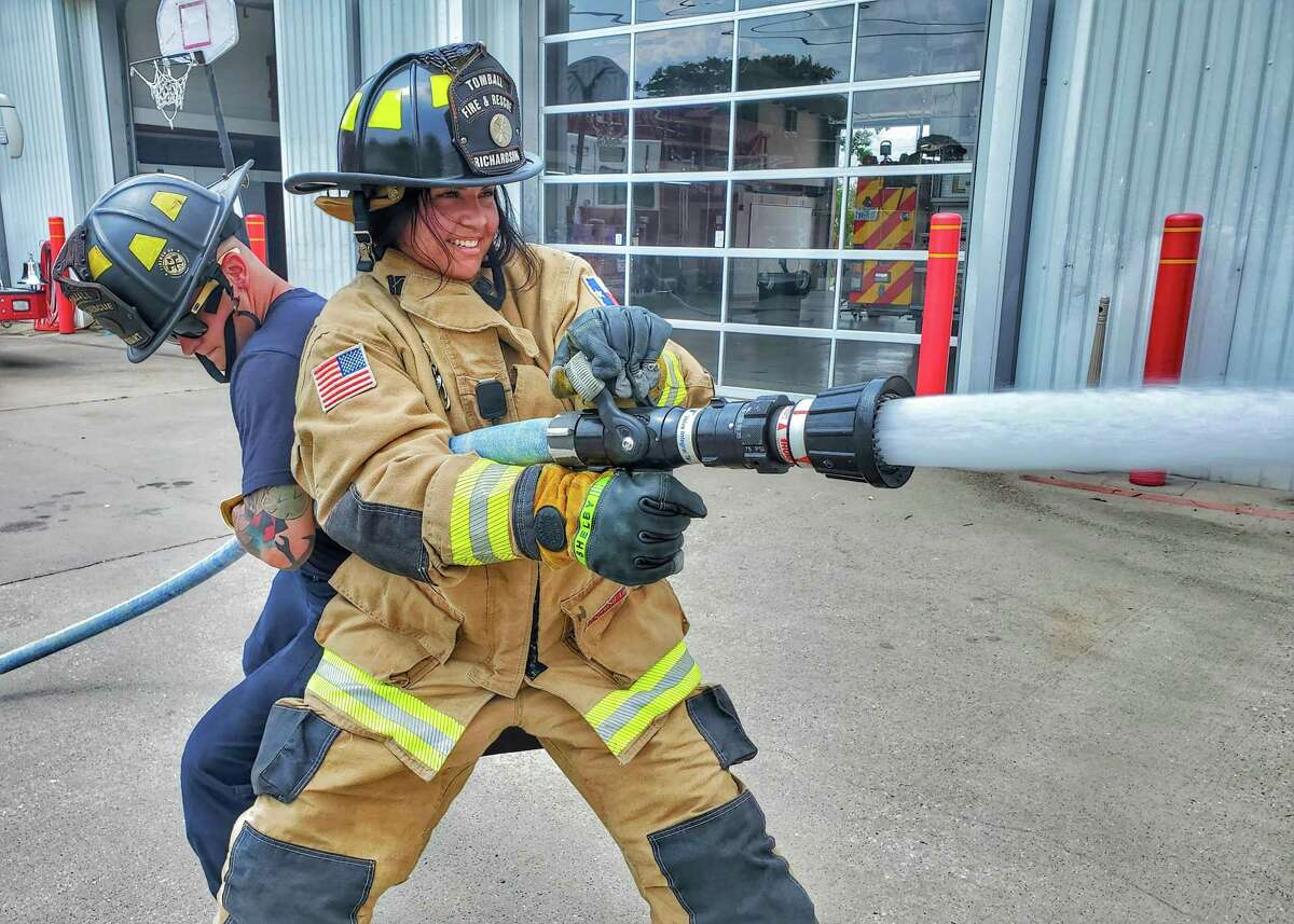 Alexis Reyes gets some backup while she maintains control of the fire hose during training at the Tomball Fire and Rescue. Reyes is interning at the department this summer as part of her training in preparation for a career in law enforcement at Sam Houston State University.