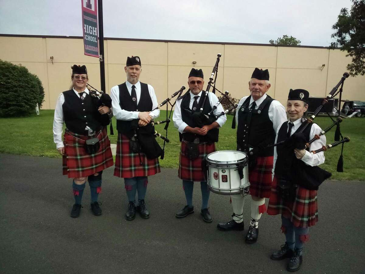 Torrington High School's class of 2021 graduated Friday night on the school campus' football field. The Litchfield Hills Pipe Band marched the class onto the field.