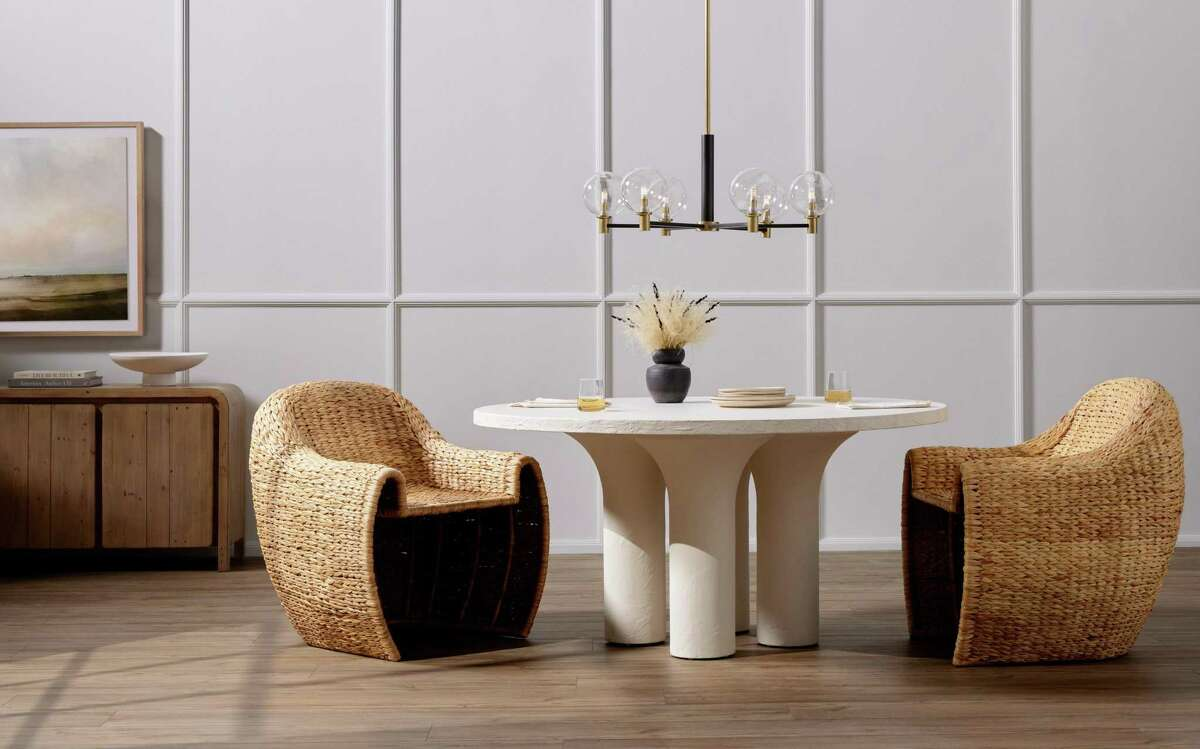 Four Hands' Parra dining table, Iola dining chairs and a Kendrick chandelier.
