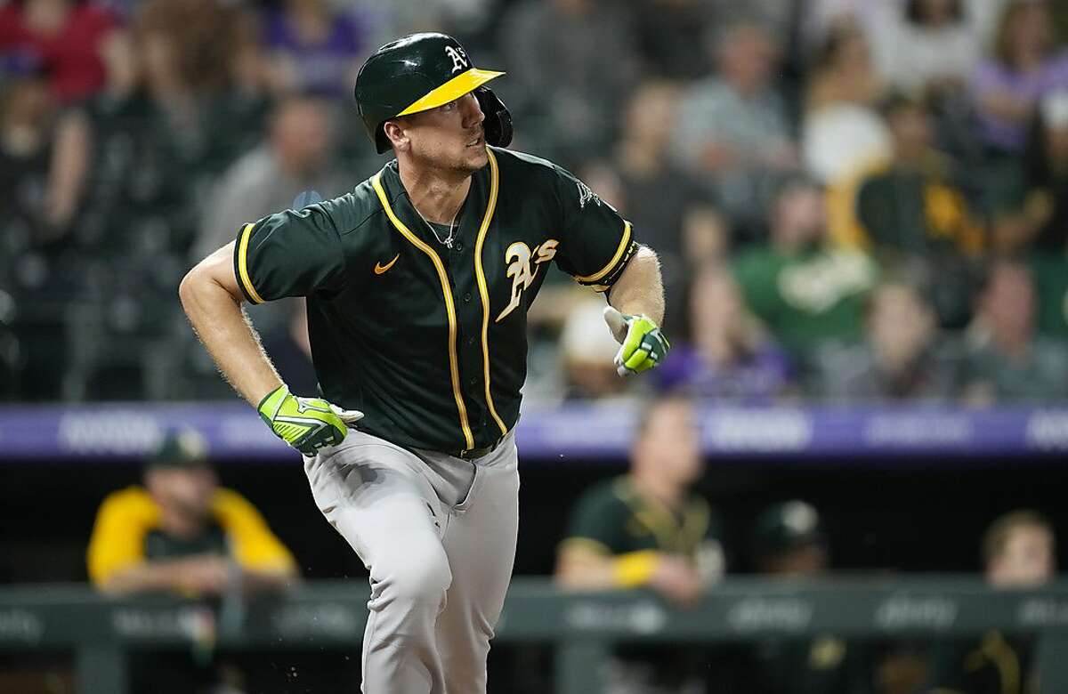 Oakland Athletics' Stephen Piscotty heads up the first base line after singling against Colorado Rockies starting pitcher Kyle Freeland in the fifth inning of a baseball game Saturday, June 5, 2021, in Denver. (AP Photo/David Zalubowski)