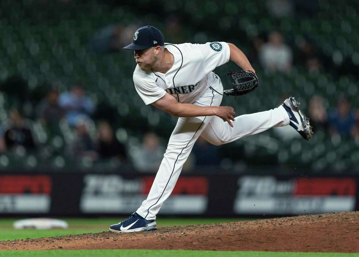 Seattle Mariners reliever Will Vest follows through on a pitch during the ninth inning of the team's baseball game against the Minnesota Twins, Tuesday, June 15, 2021, in Seattle. The Mariners won 10-0. (AP Photo/Stephen Brashear)