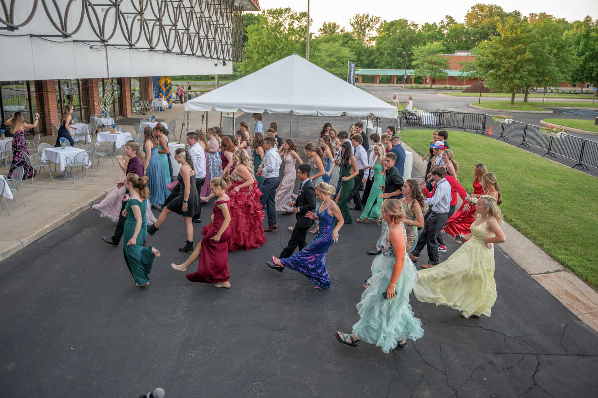 Students dance during a privately funded senior prom for Midland High School Friday, June 18, 2021 at the Midland Center for the Arts. (Adam Ferman/for the Daily News)