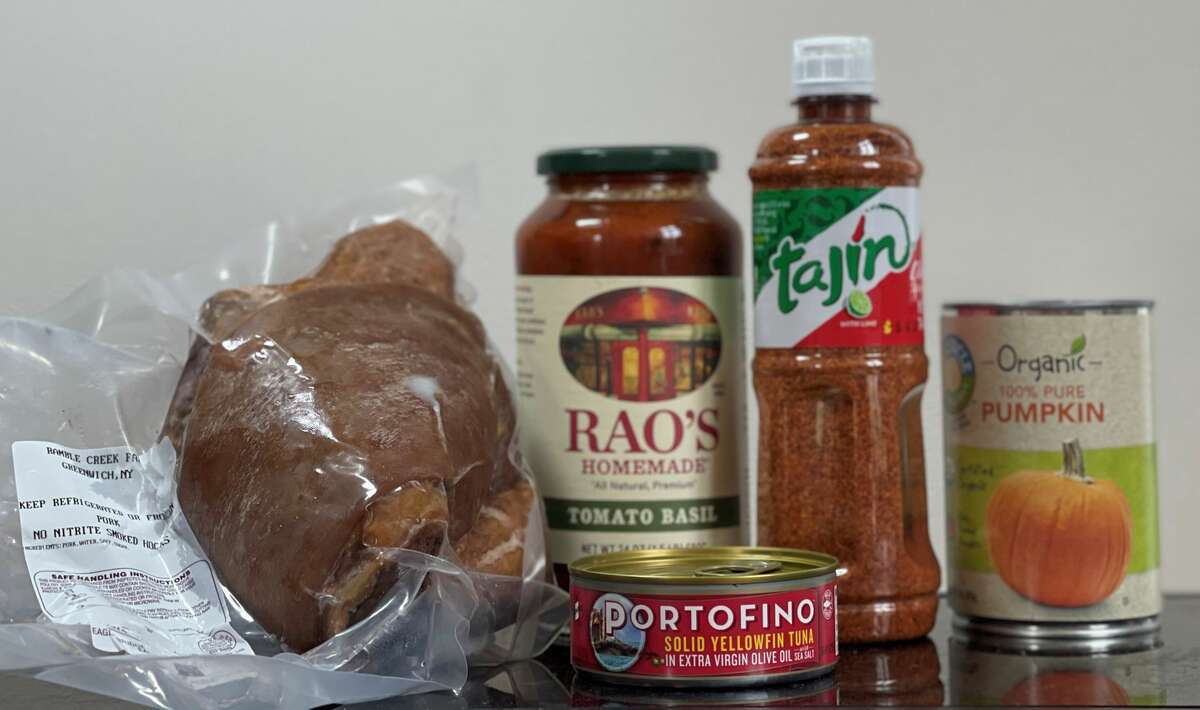 Pantry essentials for Ordinary Cook blogger Ralph Elwell of Saratoga Springs include, from left, local ham hock, Rao's pasta sauce, oil-packed tuna, Tajin seasoning and canned pumpkin. (Ralph Elwell/for the Times Union)