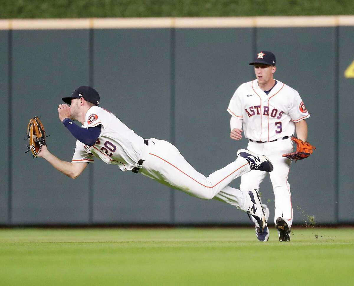Chas McCormick, making a diving catch in the outfield earlier this week against Chicago, brings non-stop energy to Astros.