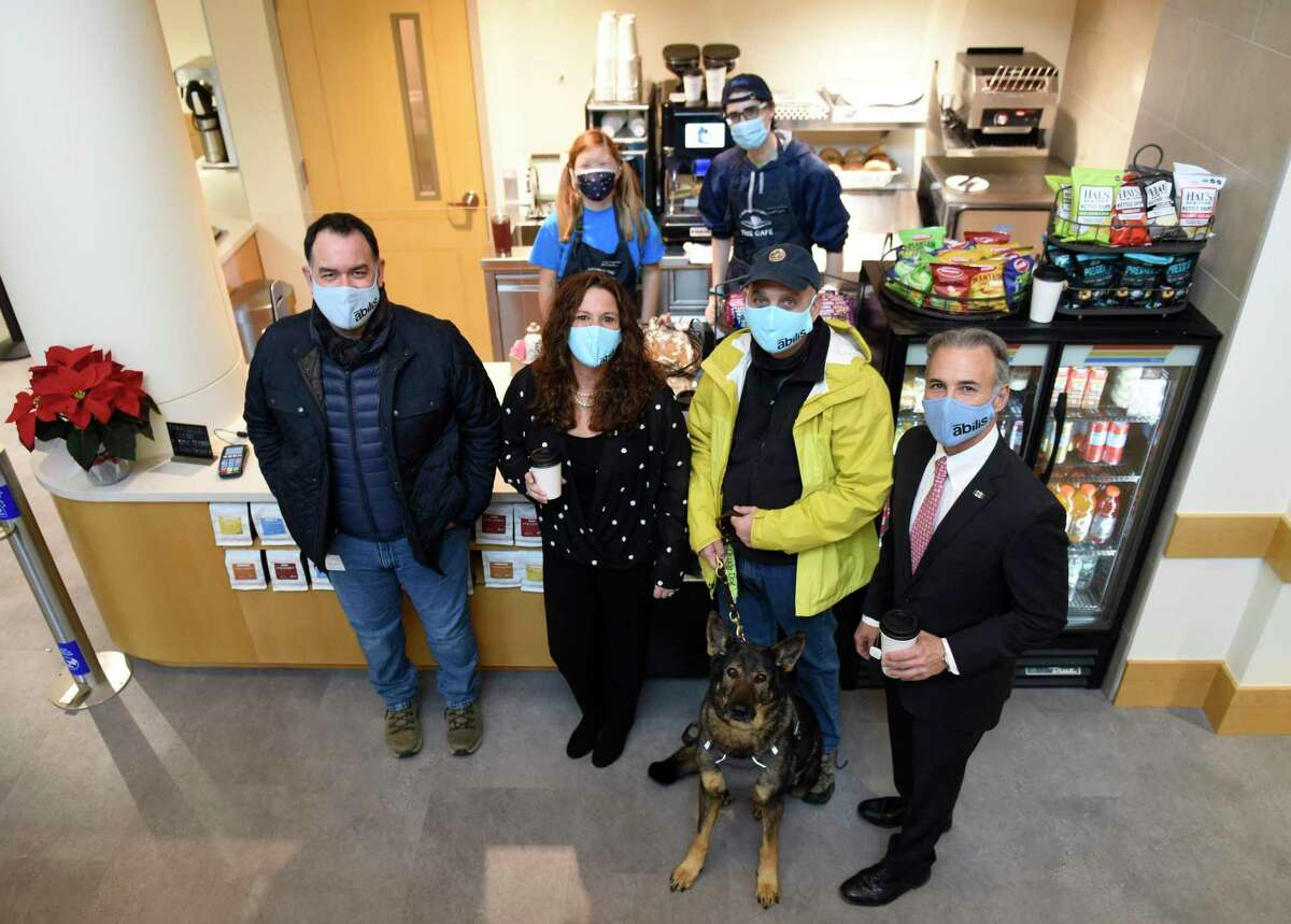 Folks pose together at the opening of the new Cafe at Greenwich Library on Dec. 14, 2020. The cafe is a partnership between the library and Abilis to provide employment for young adults with special needs. Abilis plans to open a similar one in Darien.