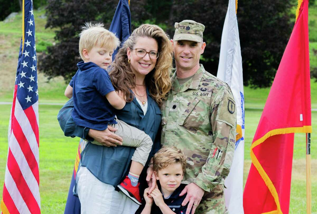 Lt. Col. Jeffery L. Csoka, the incoming commander of the 106th Regiment (RTI), stands with his family during a change of command ceremony at Camp Smith Training Site in Cortlandt Manor, N.Y., on June 12.