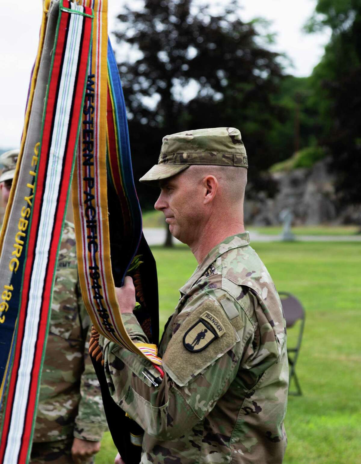 Col. Diane M. Armbruster, the outgoing commander of the 106th Regiment (RTI), relinquished command to Lt. Col. Jeffery L. Csoka, the incoming commander of the 106th Regiment (RTI), during a change of command ceremony at Camp Smith Training Site in Cortlandt Manor, N.Y., on June 12, 2021.