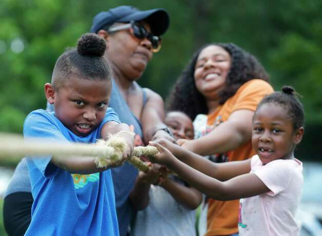 Santana Johnson, left, competes in a tug-of-war contest during a Juneteenth celebration at Kasmiersky Park, Saturday, June 19, 2021, in Conroe. Juneteenth, which recently became a federal holiday after being signed into law this week by President Joe Biden, recognizes the end of slavery in the United States. It is held on June 19, the anniversary of the announcement of emancipation for enslaved people in Texas in 1865, nearly three years after President Abraham Lincoln signed the Emancipation Proclamation. Photo: Jason Fochtman, Staff Photographer / 2021 © Houston Chronicle