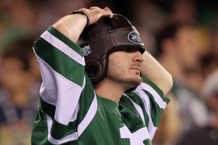 EAST RUTHERFORD, NJ - SEPTEMBER 13: A fan of the New York Jets reacts after a play against the Baltimore Ravens during their home opener at the New Meadowlands Stadium on September 13, 2010 in East Rutherford, New Jersey. (Photo by Jim McIsaac/Getty Images)