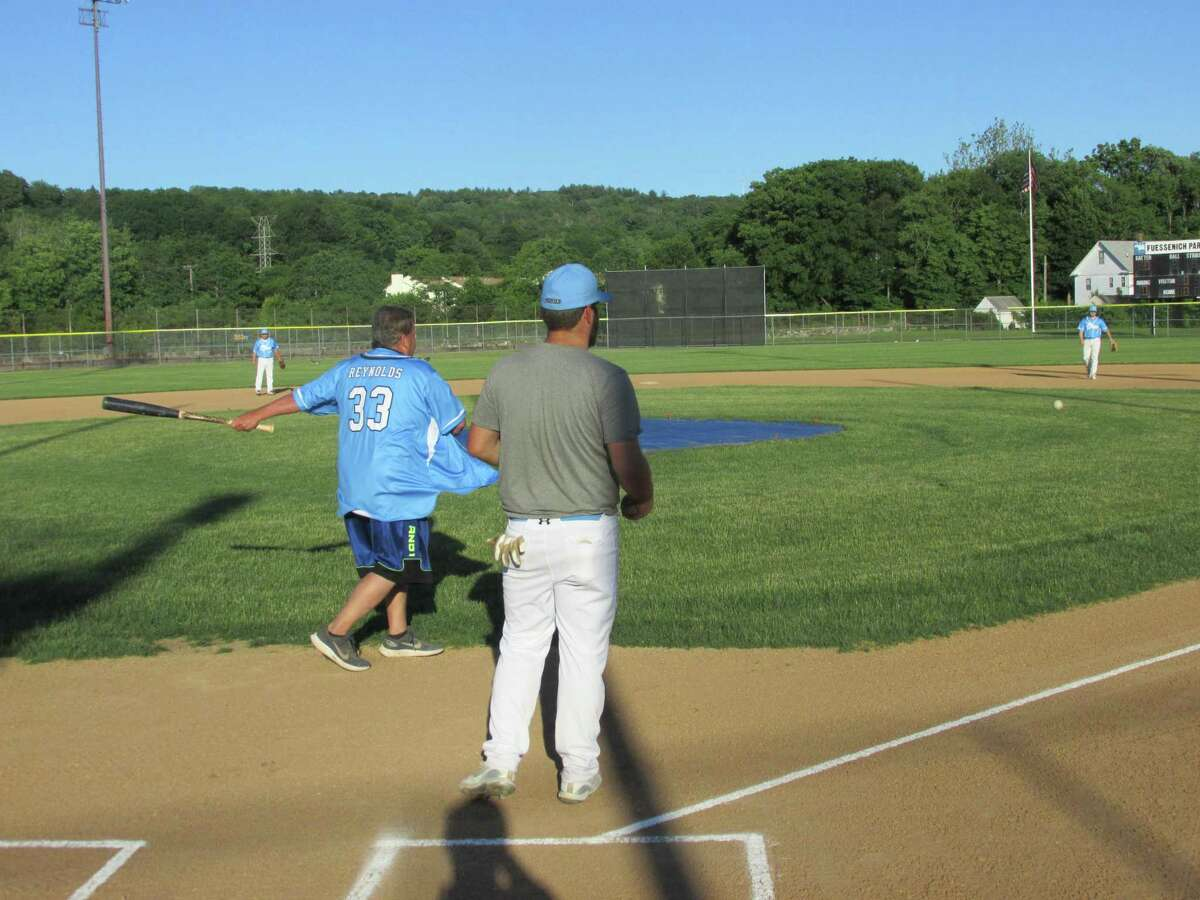 Coach John Reynolds warms up the newest team in the Tri-State Baseball League, the Twisters, at Torrington's Fuessenich Park.