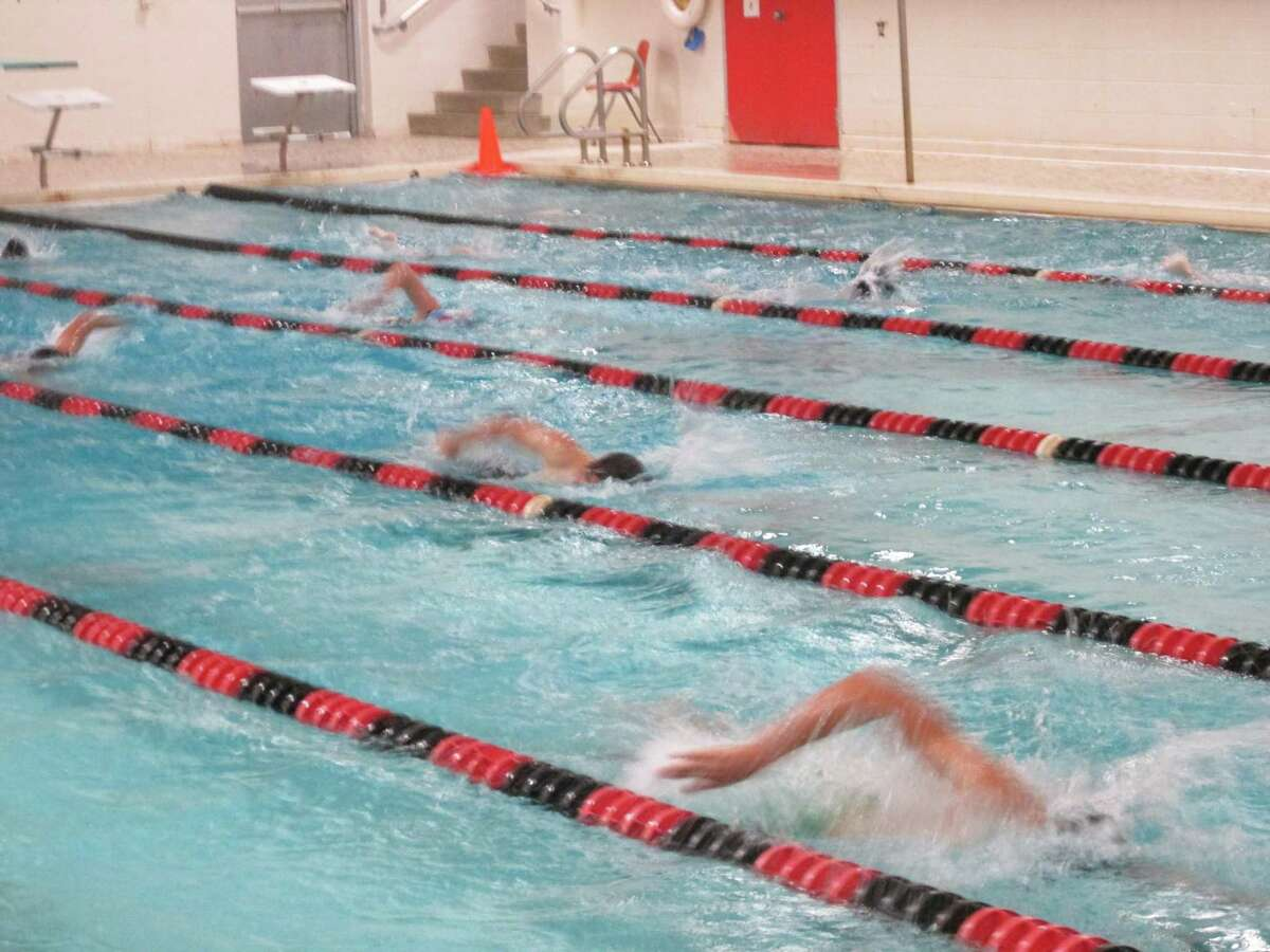 Some 20 members of the CT Lasers summer swim team practice at the Winsted branch of the Northwest CT YMCA.