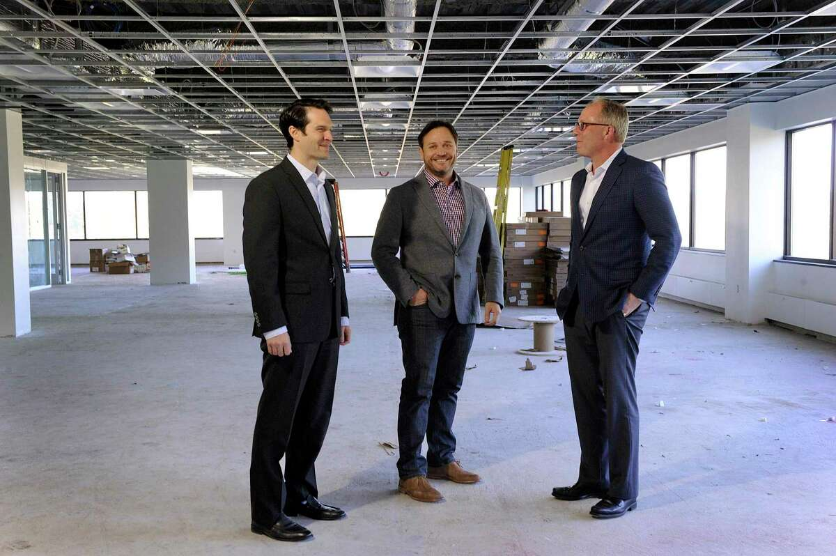 From left, Jay Lapham, portfolio manager for Allegiance Realty, Chris Smith, CEO and Todd Payne, who is the exclusive leasing agent for 44 Old Ridgebury Rd. in Danbury. They are standing in space that is being renovated for General Motors., Wed. Oct. 18, 2017.