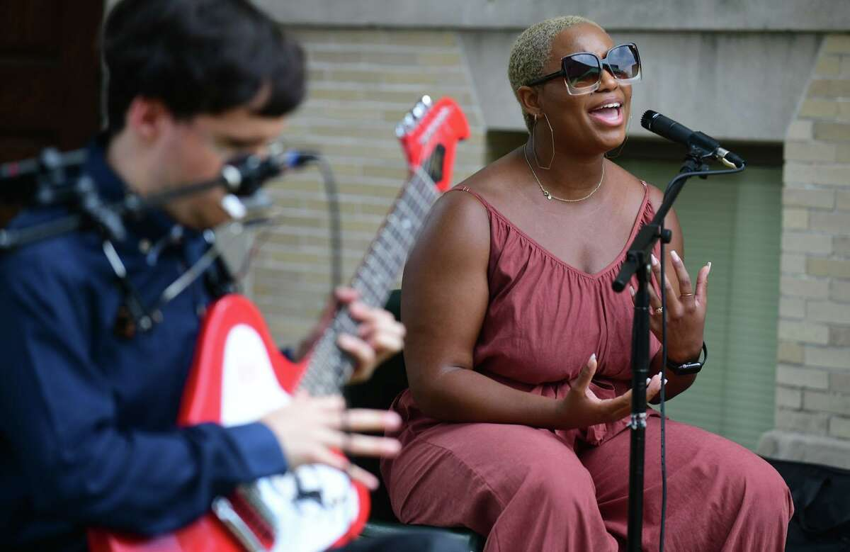 Norwalk native Saige Bryan and the Blues and Beyond band perform outside the SoNo Branch library to celebrate the Juneteenth holiday in Norwalk on Saturday.
