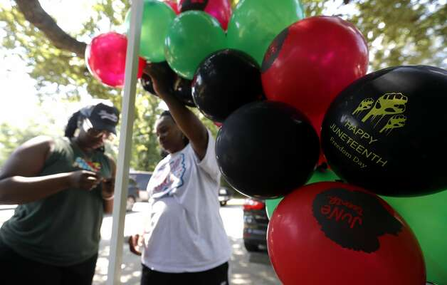 Tasia Payne, left, and her mother hang balloon during a Juneteenth celebration at Kasmiersky Park, Saturday, June 19, 2021, in Conroe. Juneteenth, which recently became a federal holiday after being signed into law this week by President Joe Biden, recognizes the end of slavery in the United States. It is held on June 19, the anniversary of the announcement of emancipation for enslaved people in Texas in 1865, nearly three years after President Abraham Lincoln signed the Emancipation Proclamation. Photo: Jason Fochtman/Staff Photographer / 2021 ? Houston Chronicle