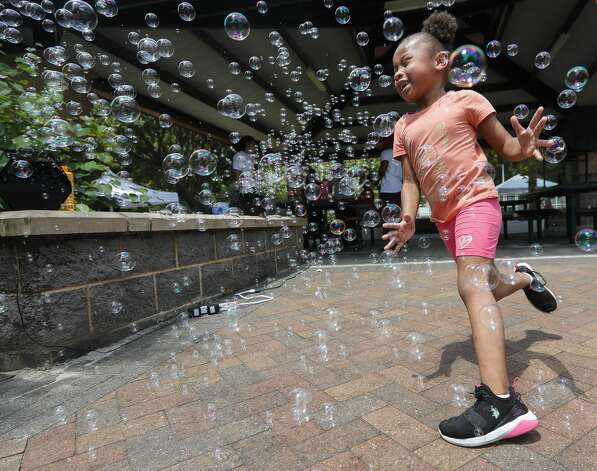 Gracis Johnson runs through bubbles during a Juneteenth celebration at Kasmiersky Park, Saturday, June 19, 2021, in Conroe. Juneteenth, which recently became a federal holiday after being signed into law this week by President Joe Biden, recognizes the end of slavery in the United States. It is held on June 19, the anniversary of the announcement of emancipation for enslaved people in Texas in 1865, nearly three years after President Abraham Lincoln signed the Emancipation Proclamation. Photo: Jason Fochtman/Staff Photographer / 2021 ? Houston Chronicle