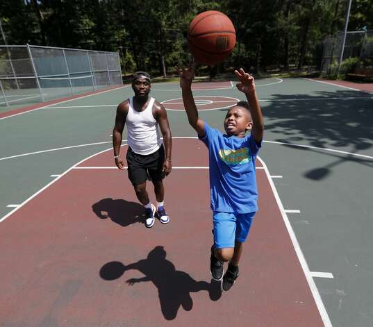 Santana Johnson, right, shoots a basket past Von Gardner during a Juneteenth celebration at Kasmiersky Park, Saturday, June 19, 2021, in Conroe. Juneteenth, which recently became a federal holiday after being signed into law this week by President Joe Biden, recognizes the end of slavery in the United States. It is held on June 19, the anniversary of the announcement of emancipation for enslaved people in Texas in 1865, nearly three years after President Abraham Lincoln signed the Emancipation Proclamation. Photo: Jason Fochtman/Staff Photographer / 2021 ? Houston Chronicle