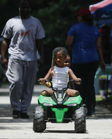 Layla Ford rides on a motorized car with her brother, Thomas, during a Juneteenth celebration at Kasmiersky Park, Saturday, June 19, 2021, in Conroe. Juneteenth, which recently became a federal holiday after being signed into law this week by President Joe Biden, recognizes the end of slavery in the United States. It is held on June 19, the anniversary of the announcement of emancipation for enslaved people in Texas in 1865, nearly three years after President Abraham Lincoln signed the Emancipation Proclamation. Photo: Jason Fochtman/Staff Photographer / 2021 © Houston Chronicle