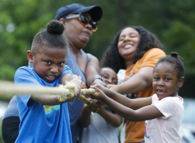 Santana Johnson, left, competes in a tug-of-war contest during a Juneteenth celebration at Kasmiersky Park, Saturday, June 19, 2021, in Conroe. Juneteenth, which recently became a federal holiday after being signed into law this week by President Joe Biden, recognizes the end of slavery in the United States. It is held on June 19, the anniversary of the announcement of emancipation for enslaved people in Texas in 1865, nearly three years after President Abraham Lincoln signed the Emancipation Proclamation. Photo: Jason Fochtman/Staff Photographer / 2021 © Houston Chronicle