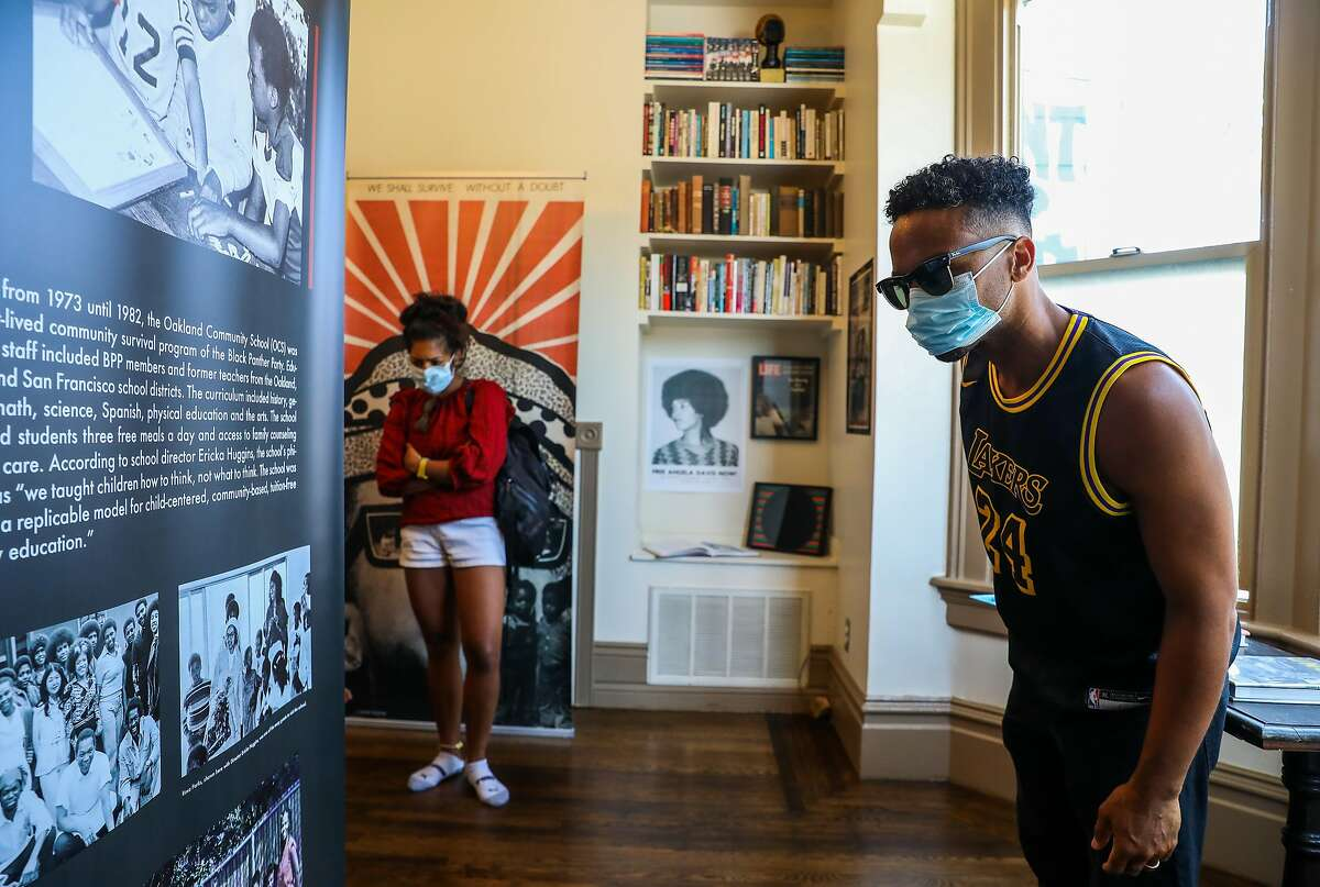 Kiran Sidhu and her husband David Carlisle of Sacramento attend the opening of the Mini Museum in Oakland. Jilchristina Vest is the director/curator of the museum, which focuses on the Black Panther Party.