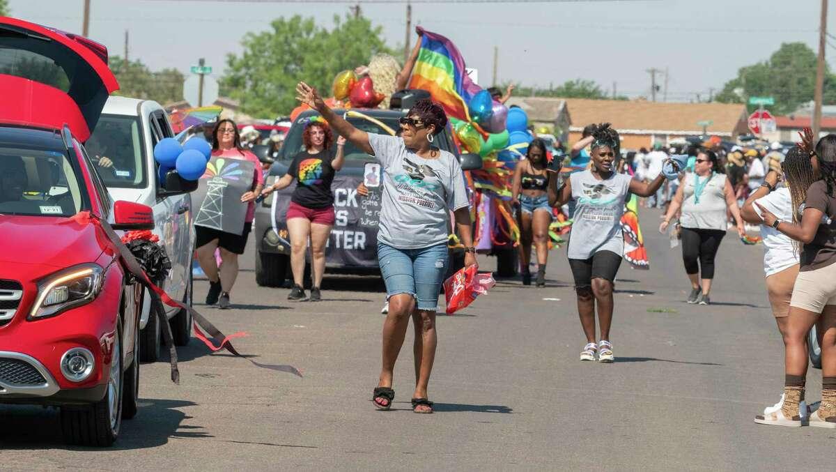 Participants walk, ride and dance their way toward Washington Park 06/19/2021 morning during the Juneteenth Parade. Tim Fischer/Reporter-Telegram