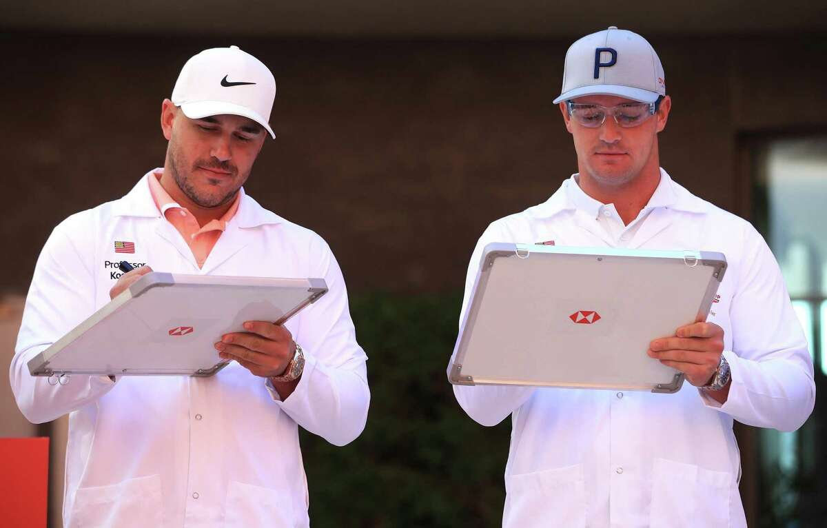 Brooks Koepka, left, and Bryson DeChambeau attend the launch of The Abu Dhabi HSBC Championship in January of 2020 in the United Arab Emirates.