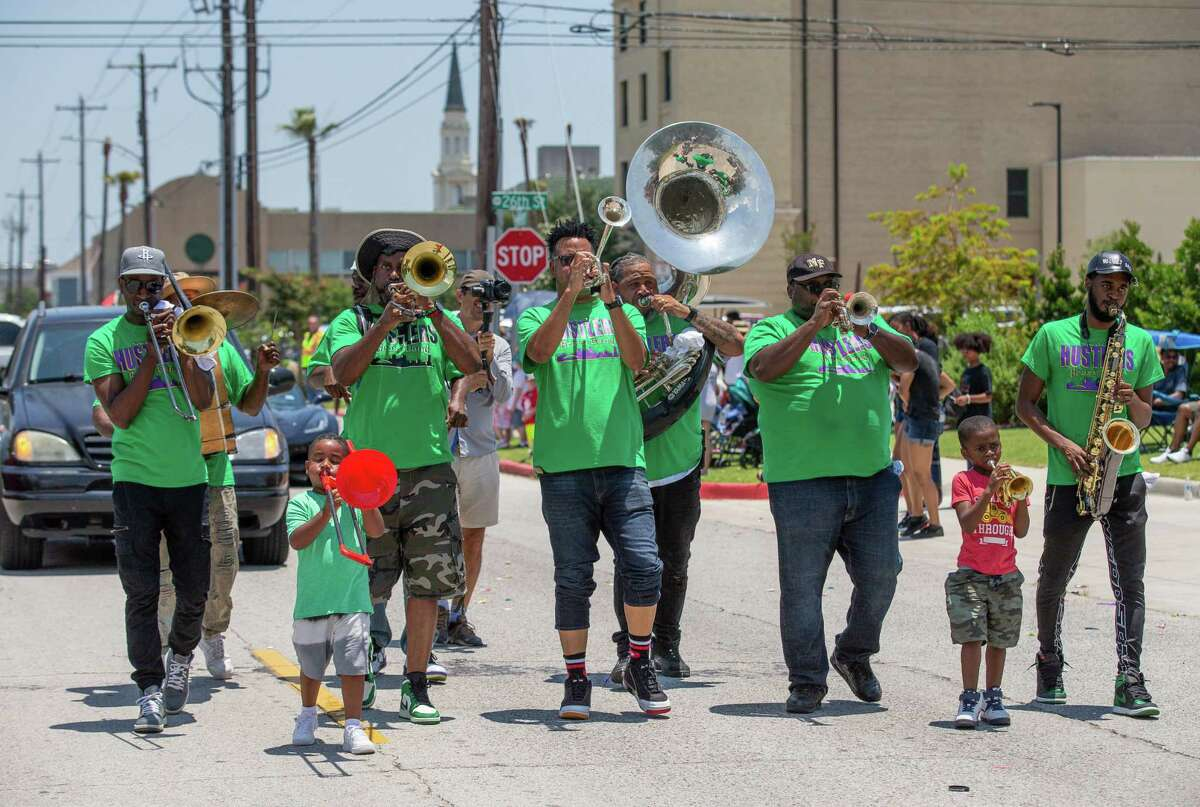 Band members play for a crowd of Galveston residents and visitors attending the Juneteenth Parade on Saturday.