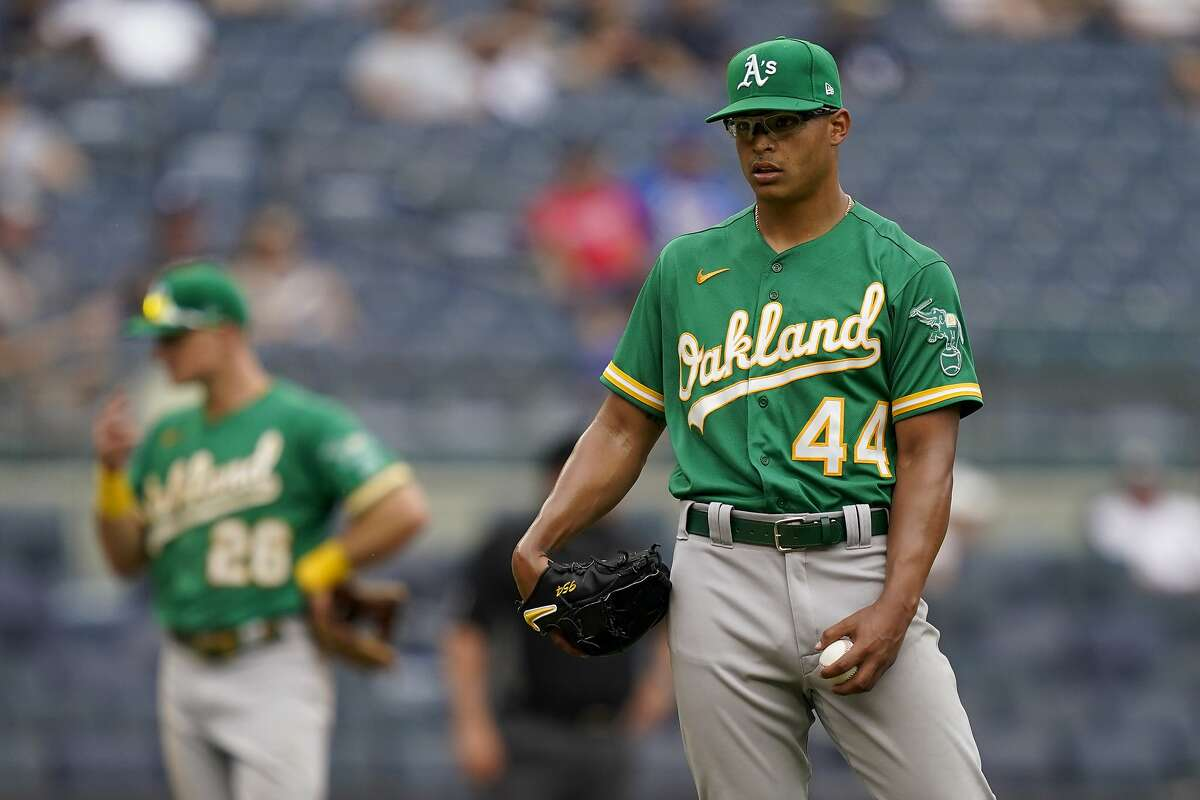 Oakland Athletics' Jesus Luzardo reacts after giving up a go-ahead solo home run to New York Yankees' Gio Urshela in the eighth inning.