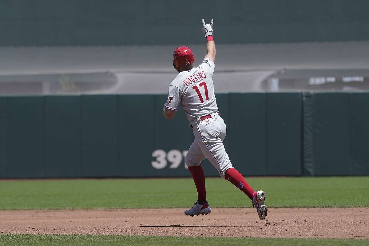 Philadelphia Phillies' Rhys Hoskins gestures as he rounds the bases after hitting a two-run home run during the second inning of a baseball game against the San Francisco Giants in San Francisco, Saturday, June 19, 2021. (AP Photo/Jeff Chiu)