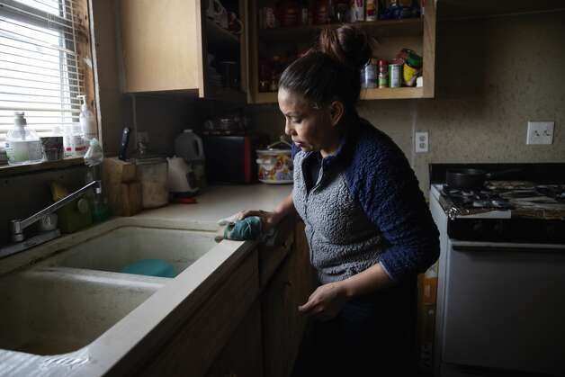 Maria Pineda cleans the kitchen of a home, where she temporarily stays, Thursday, Feb. 18, 2021, in Conroe. Pineda's son, Cristian Pavon Pineda, 11-years-old, died of suspected hypothermia as temperatures plummeted into the teens on Tuesday, Feb. 16. Photo: Gustavo Huerta/Staff Photographer / Houston Chronicle © 2021