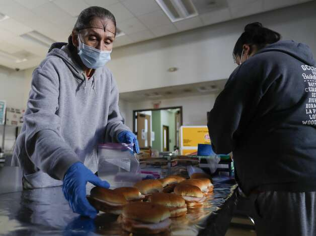 Betty Bradley helps prepare lunch for the next day at the Salvation Army, Tuesday, Feb. 16, 2021, in Conroe. The shelter lost power but has remained open to community members. Photo: Jason Fochtman/Staff Photographer / 2021 © Houston Chronicle