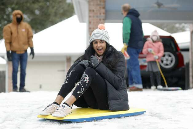 Rahi Patel yells as she slides down an icy driveway after snow covered homes and roadways through out Greater Houston, Monday, Feb. 15, 2021, in Kingwood. Photo: Jason Fochtman/Staff Photographer / 2021 © Houston Chronicle