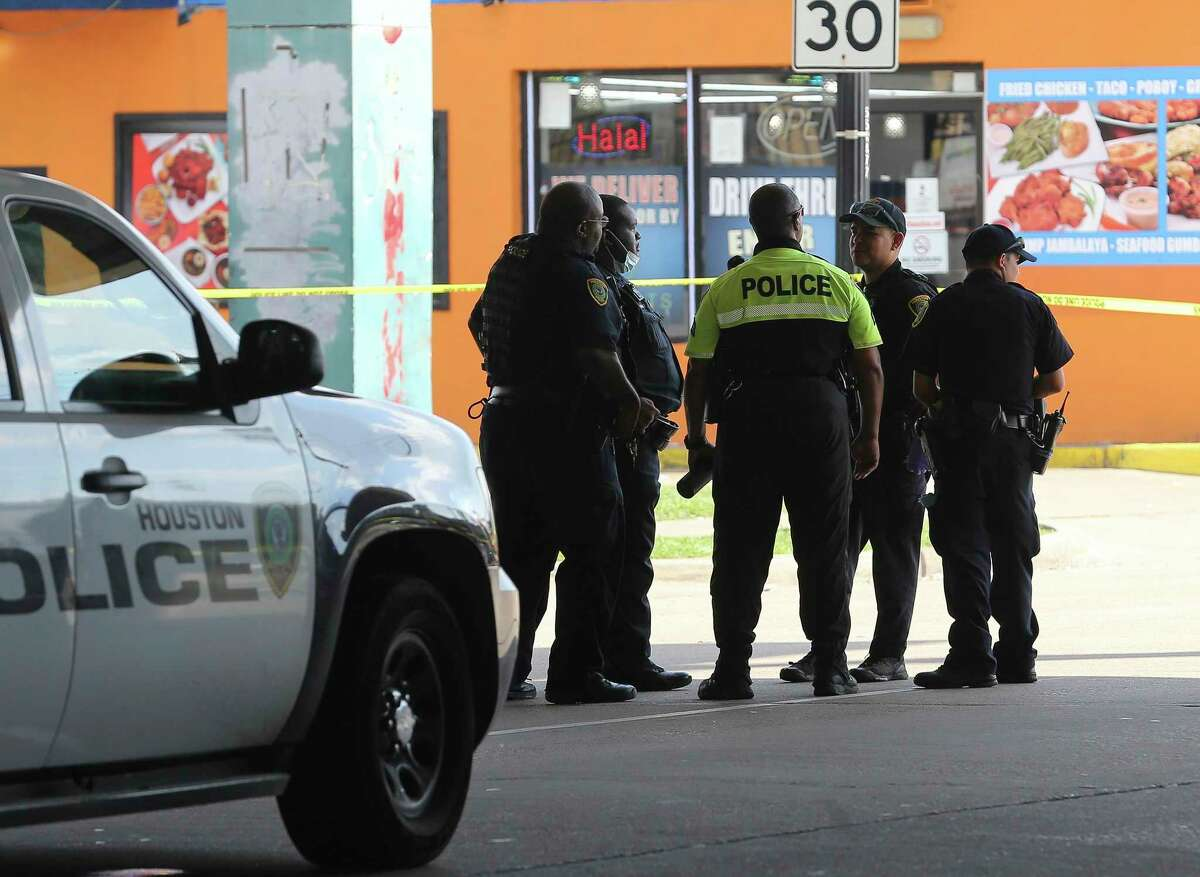 Houston Police Department officials respond and investigate a triple shooting with one person dead at 1900 Main Street Saturday, June 19, 2021, in Houston. The suspect in the shooting at Main and Pierce streets fled, according to Houston police.