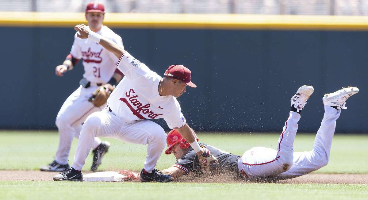 North Carolina State's (12) Austin Murr steals second base ahead of the tag from Stanford's Adam Crampton (10) in the first inning in the opening baseball game of the College World Series, Saturday, June 19, 2021, at TD Ameritrade Park in Omaha, Neb. (AP Photo/Rebecca S. Gratz)