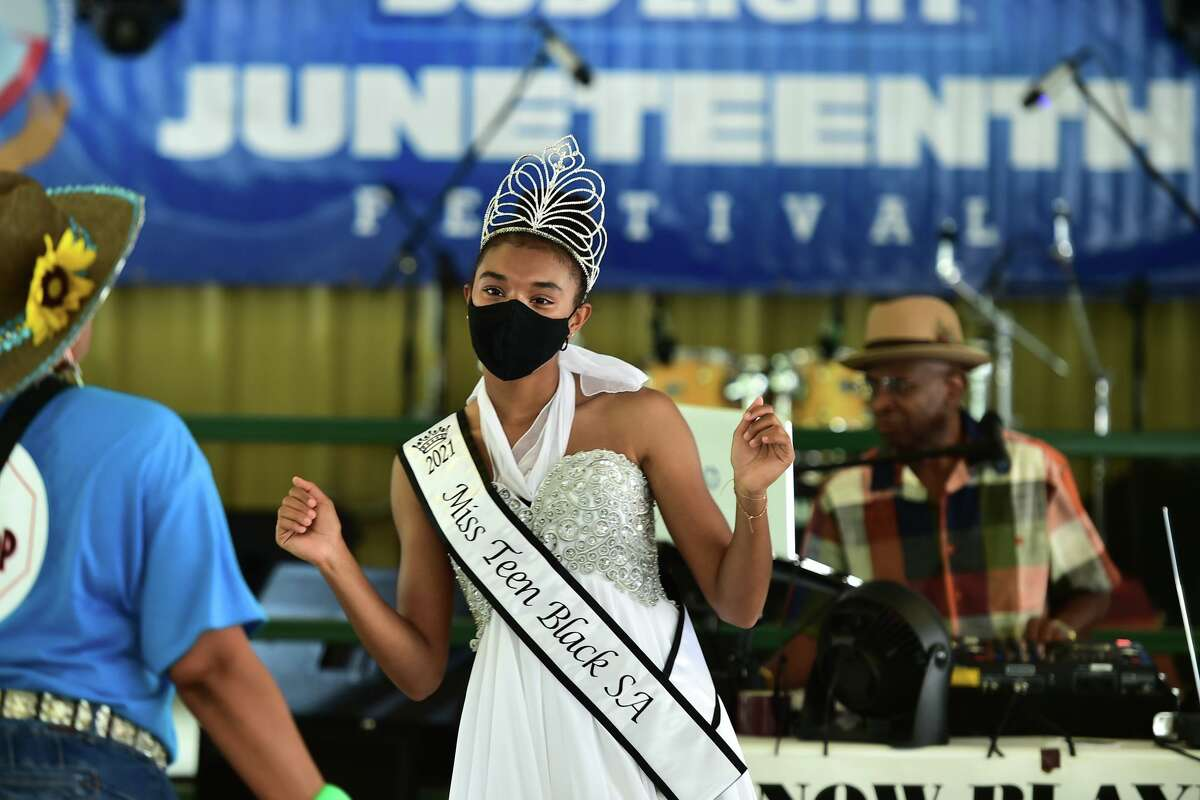 Iman Zakaria, Miss Teen Black San Antonio, dances during the Juneteenth Festival at Comanche Park on June 19. Bexar County Commissioners voted last week to make Juneteenth a county holiday.