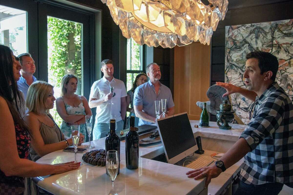 James Cerda, vice president of operations, gives guests a brief history of Theorem Vineyards.
