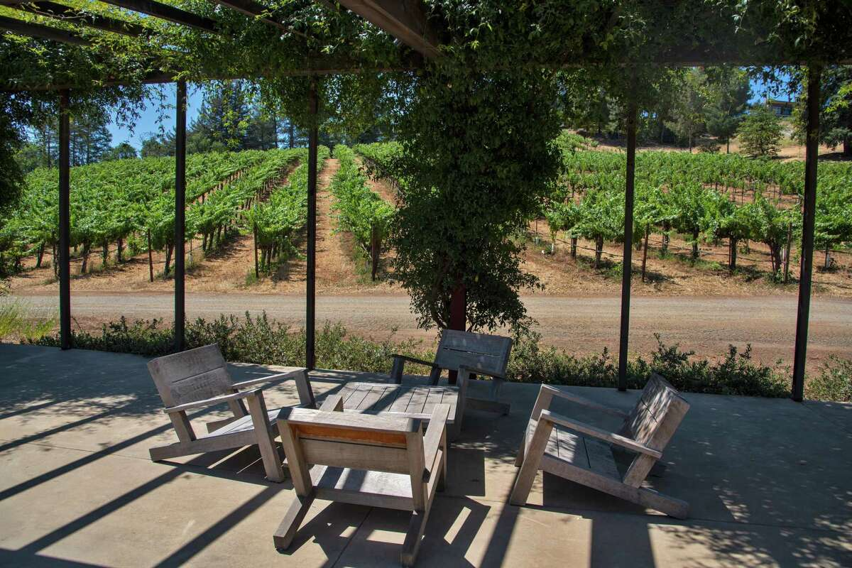 The outdoor seating area at Theorem Vineyards offers views of the vineyards.