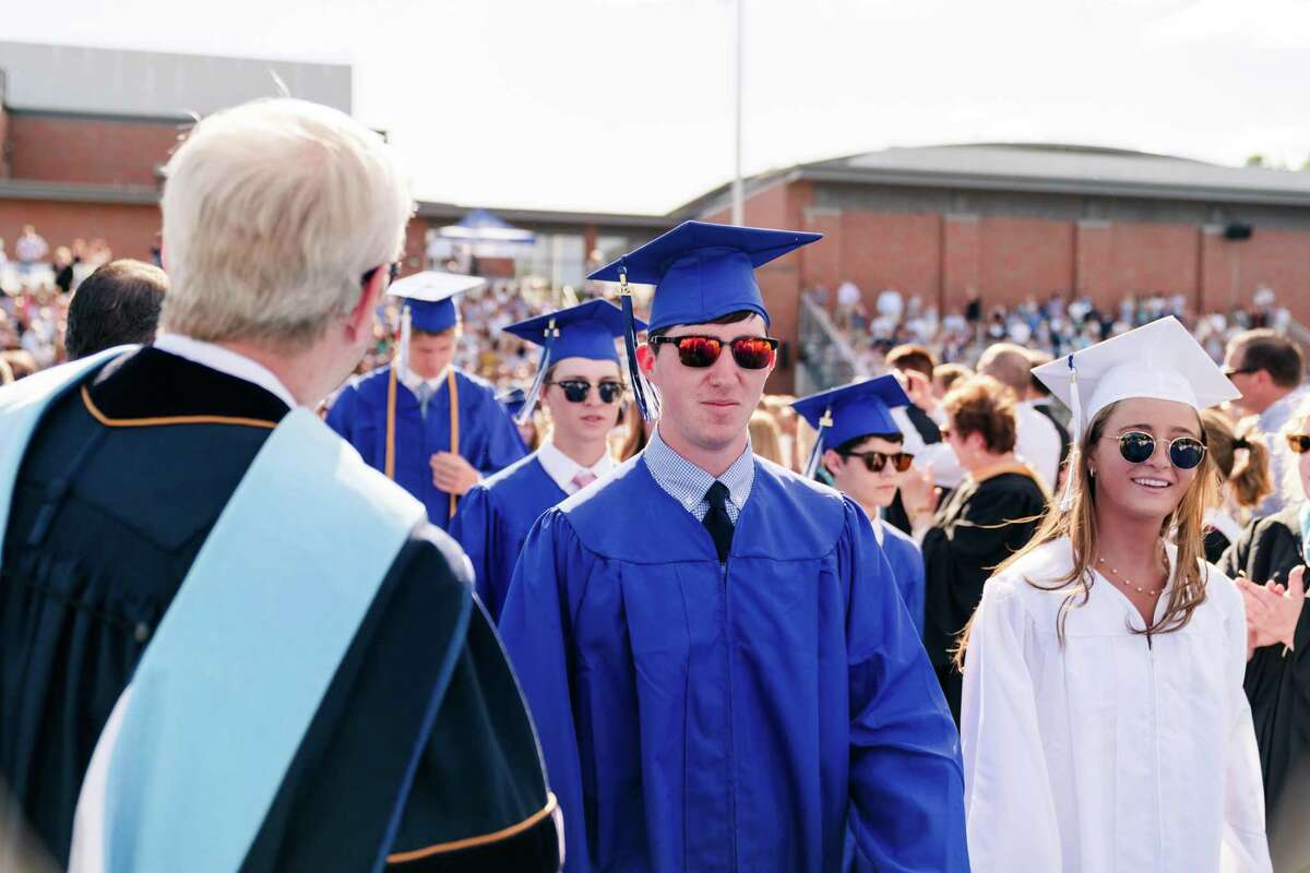 Members of the Darien High Class of 2021 in the processional during the graduation ceremony on the high school grounds Wednesday.